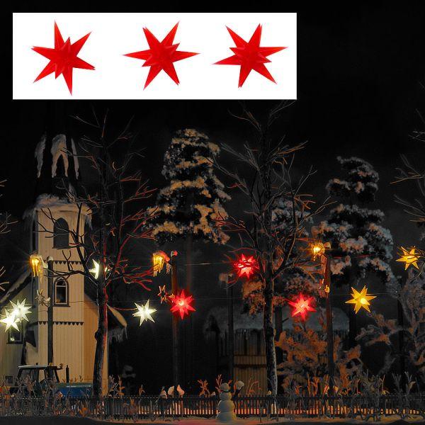 Drei rot leuchtende Weihnachtssterne