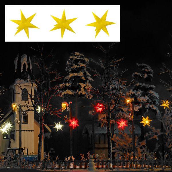 Drei gelb leuchtende Weihnachtssterne