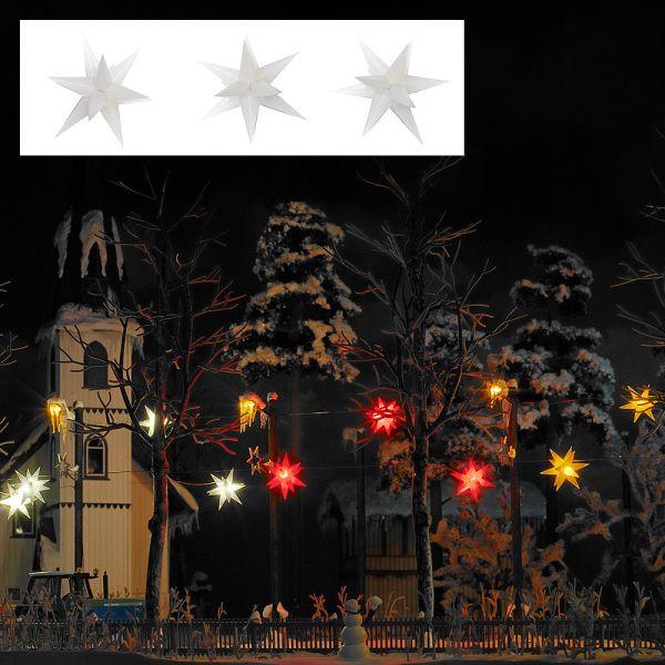 Drei weiß leuchtende Weihnachtssterne